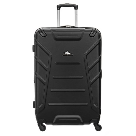 CLOSEOUTS. High Sierraand#39;s Rocshell spinner suitcase offers hard-sided protection that rolls effortlessly. The expandable main compartment has a zip divider so you stay organized, as well as a lined interior with multiple compartments. Available Colors: BLACK, MERCURY/RED LINE, MIDNIGHT/VIVID.