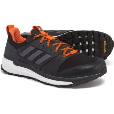 133092730 adidas Supernova Trail Running Shoes (For Men) in Carbon Core Black Orange
