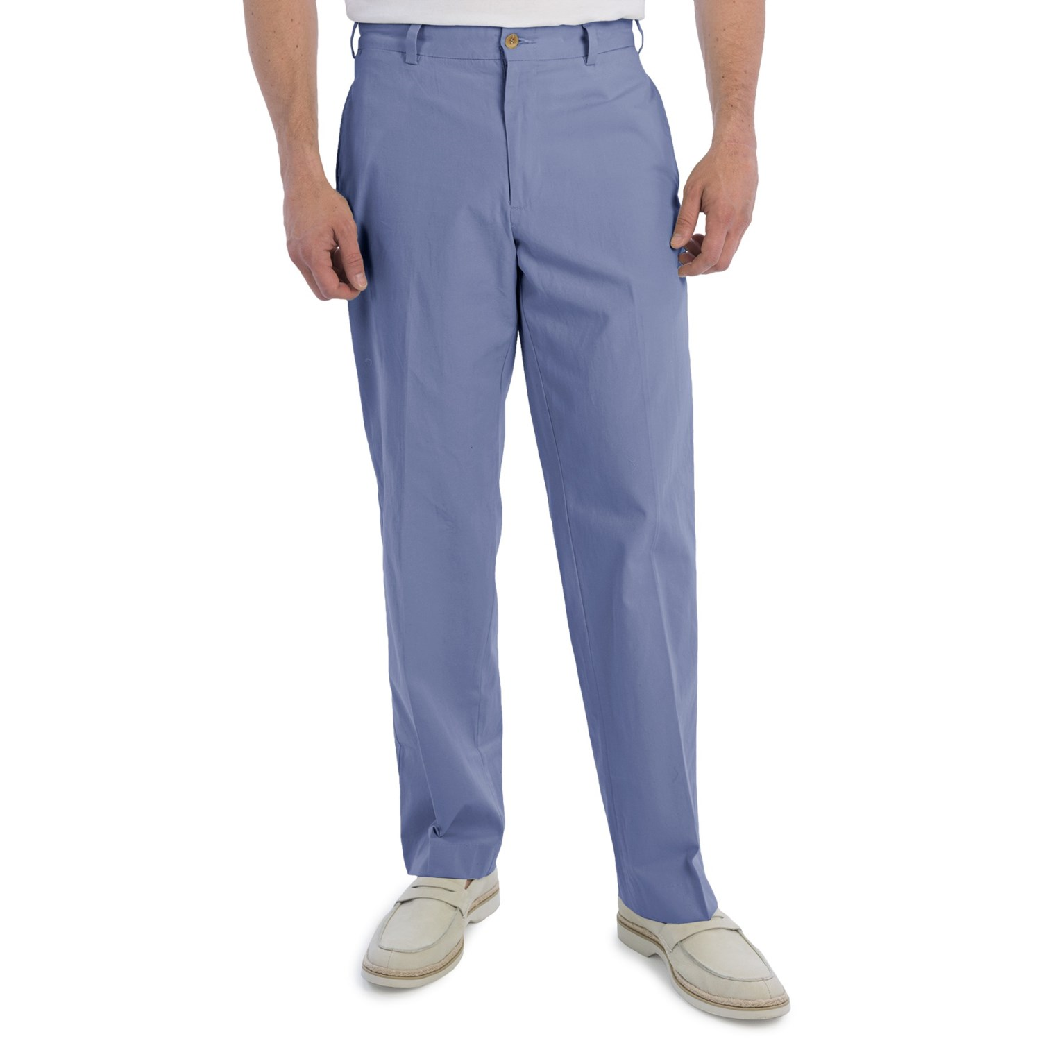 Men, meet the pleated poplin pant. Available at our own store in shades of blue, white, khaki, grey, and orange, you can do a lot with these pants—but the key to pulling them off in a complete outfit?