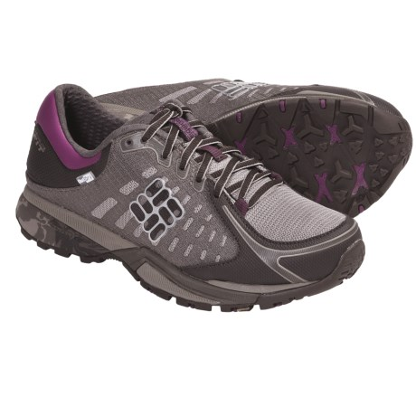 Columbia Sportswear PeakFreak Low OutDry® Trail Shoes (For Women) in Mud/Berry Jam