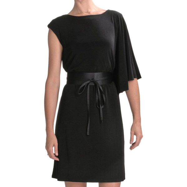 CLOSEOUTS . Exquisite! Made from a silky-soft jersey, this Chetta B one-shoulder bat wing dress will garner compliments galore, with its deliciously offset single-shoulder drape and faux-snakeskin belt. Available Colors: BLACK W/BROWN BELT, IVORY, EMERALD, BLACK W/BLACK BELT, PURPLE. Sizes: 4, 6, 8, 10, 12, 14, 16.