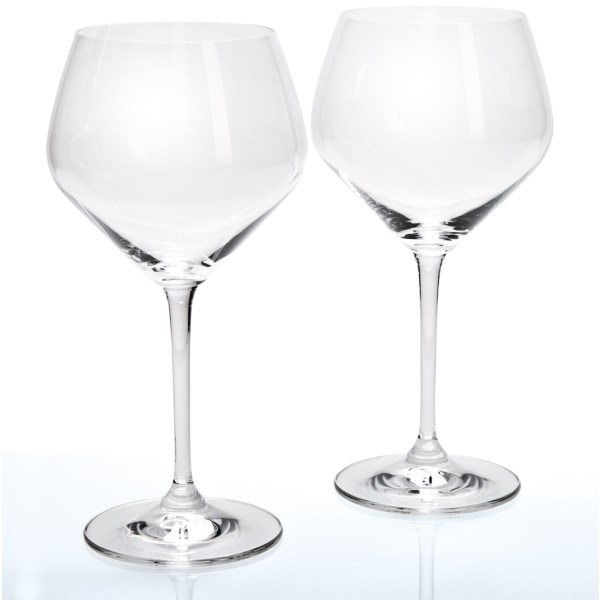 CLOSEOUTS . Wine enthusiasts can easily detect the influence of oak on a fine glass of wine, and Reidel's Heart to Heart oaked chardonnay wine glass is shaped to enhance this unique character.      Set of two    Backed by 250 years of German glassmaking excellence, Riedel crystal glassware is meticulously designed to enhance the character of the spirits by the unique shape of the glass    All glasses made of lead-free crystal     Height:  9andquot;     Diameter:  4-1/2andquot;     Weight:  7.2 oz.     Material:  Lead-free crystal     Care:  Dishwasher safe    Made in Germany    Please disregard promotion labeling on some packaging; Sierra Trading Post was able to purchase these goods at an exceptional price because of excess inventory in this packaging     Available Colors: SEE PHOTO.