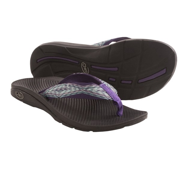 CLOSEOUTS . If foot-slapping sandals make you flip out, lose the andquot;flopandquot; through the ingenuity of Chaco's Flip EcoTread thong sandals, which remove the flopping effect by seating the upper straps back under the midfoot of the anatomical LUVSEAT footbed. Available Colors: BLOSSOM, FRESH, BLACK, CAMPFIRE, CARNIVAL, MULTI RED, FIELD GREEN, FOXY BROWN, DIGITAL GREEN, PREP, SUNSET, LONGITUDE, ZEAL, FLOURISH, MISSONI, REBEL, STRIPED GREEN, ZEBRA AQUA, FIESTA, LEAF PILES, PIXEL WEAVE, STATIC GREY, STONES BLACK, PERENNIEL. Sizes: 5, 6, 7, 8, 9, 10, 11, 12, 13, 14.