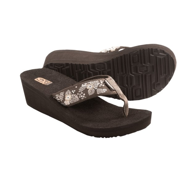 CLOSEOUTS . Find out why customers rave about Mushand#174;-- the soft, squishy and highly supportive material that forms the insole and wedge beneath Teva's Mandalyn wedge 2 sandals. Available Colors: SEA FOAM BIKING RED, LIBERTY BLACK SILVER, ABBEY PURPLE, JUNGLE BROWN, VELVET FLOWER METALLIC GOLD, PALM FLOWER BLACK, PALM FLOWER BROWN, MOTIF BLACK OUT. Sizes: 5, 6, 7, 8, 9, 10, 11, 12.