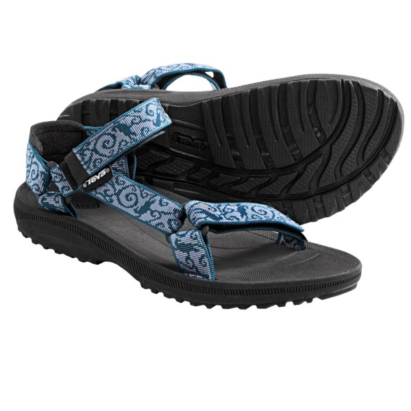 CLOSEOUTS . Water- and adventure-ready, Teva's Torin sport sandals offer support and cushion on warm-weather hikes and trips to the park thanks to adjustable straps, a compression-molded EVA midsole and shock-absorbing Shoc Padand#174; in the heel. Available Colors: ALTRI MAUVE, BLACK, BUTTERFLY SCENE BLACK, BIRDS BLUE, GRACEFUL PINK. Sizes: 5, 6, 7, 8, 9, 10, 11.