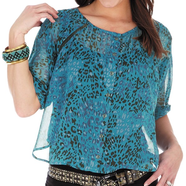 CLOSEOUTS . Take a little walk on the wild side in Wrangler's Rock 47 shirt, featuring a semi-sheer, leopard-print chiffon with lacy insets and a billowy, layer-ready appeal. Available Colors: TURQUOISE. Sizes: S, M, L, XL, 2XL.