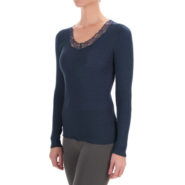 CLOSEOUTS . Awash in the elegance of soft stretch lace, Calidaand#39;s Kirstin V-neck shirt is a soft, stretchy and trim-fitting layer in ribbed wool-silk with a lace-trimmed V-neck and lettuce hem. Available Colors: PANSY VIOLET, BLACK IRIS. Sizes: XS, S, M, L.