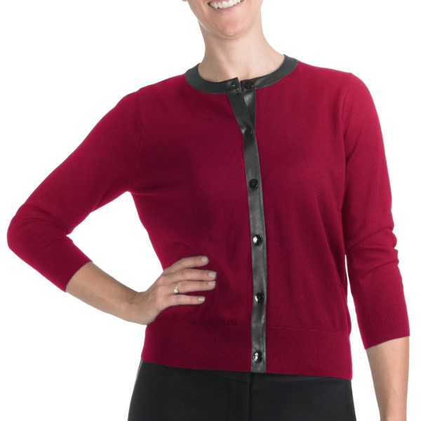 CLOSEOUTS . Elegance and edginess flawlessly combine to create this August Silk cardigan sweater, trimmed in soft pleather around the neckline and down the full-length button front. Available Colors: BLACK/BLACK, COTTON BALL, UNO RED, GREEN VALLEY. Sizes: S, M, L, XL.