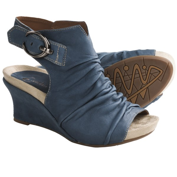 CLOSEOUTS . Wedges with their own distinct personality, Earthies Bonaire Too sandals combine a generously gathered upper with bold, silver-tone hardware and a coordinating fabric-wrapped wedge. Available Colors: MOROCCAN BLUE VINTAGE LEATHER. Sizes: 4, 5, 5.5, 6, 6.5, 7, 7.5, 8, 8.5, 9, 9.5, 10, 11, 12.