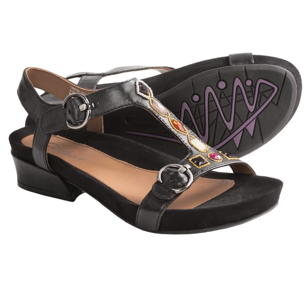 CLOSEOUTS . Bedazzle your friends and admirers with Earthiesand#39; Santini Too sandals. These classic T-strap leather sandals pop off the sidewalk with dizzying jewel accents. Available Colors: BISCUIT CALF, BLACK LEATHER. Sizes: 5, 5.5, 6, 6.5, 7, 7.5, 8, 8.5, 9, 9.5, 10, 11, 12.