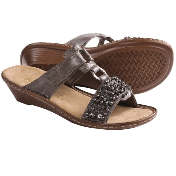 CLOSEOUTS . Not one to blend in with the crowd, Riekerand#39;s Regina 93 sandals feature an edgy upper with an architectural silhouette and unique metallic beading. Available Colors: SMOKE. Sizes: 36, 37, 38, 39, 40, 41, 42.