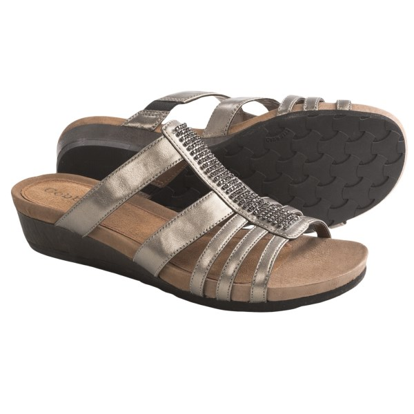 CLOSEOUTS . When the occasion calls for a little sparkle, Cobb Hilland#39;s Hayden sandal dazzles in fine patent leather with jeweled center strap. Molded footbed is softly cushioned in foam. Available Colors: BLACK PATENT, PEWTER, WHITE PATENT. Sizes: 6, 6.5, 7, 7.5, 8, 8.5, 9, 9.5, 10, 11, 12.