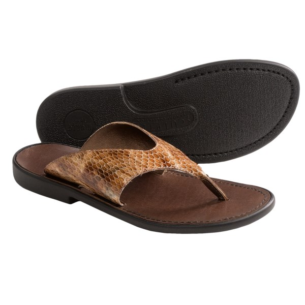 CLOSEOUTS . Part summery thong, part snazzy slide, Munro Americanand#39;s Hera sandals lend an exotic, fashionable touch, thanks to embossed patent leather straps and a stitched leather footbed. Available Colors: DARK BROWN, TAN PATENT, BLACK PATENT. Sizes: 5, 5.5, 6, 6.5, 7, 7.5, 8, 8.5, 9, 9.5, 10, 10.5, 11, 12, 13.