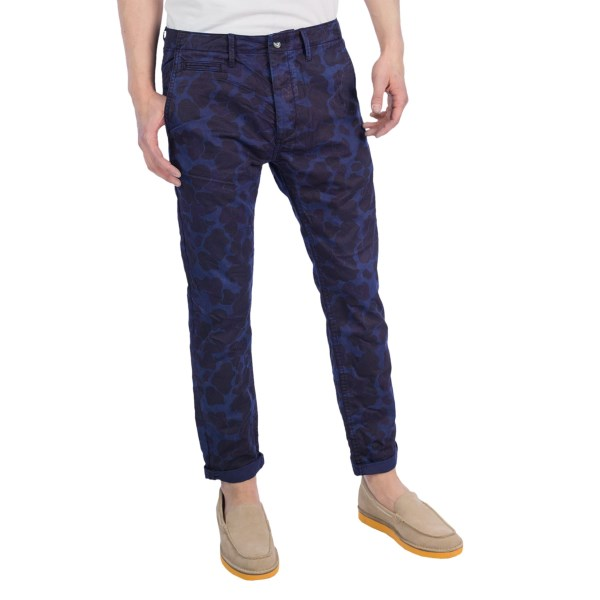 CLOSEOUTS . Shades of indigo create a subtle pattern reminiscent of camouflage in these cuffed, slim-cut jeans from Scotch andamp; Soda Available Colors: INDIGO.
