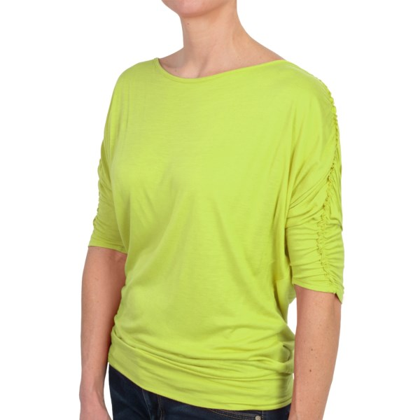 CLOSEOUTS . Elegance with a touch of playful whimsy -- thatand#39;s Joan Vassand#39; ballet neck shirt, the former achieved through soft, flowing fabric and the latter via raw-end ruching down each sleeve. Available Colors: OLIVE, COBALT BLUE, HONEYDEW, CORAL ORANGE, 001 BLACK. Sizes: S, M, L, XL.
