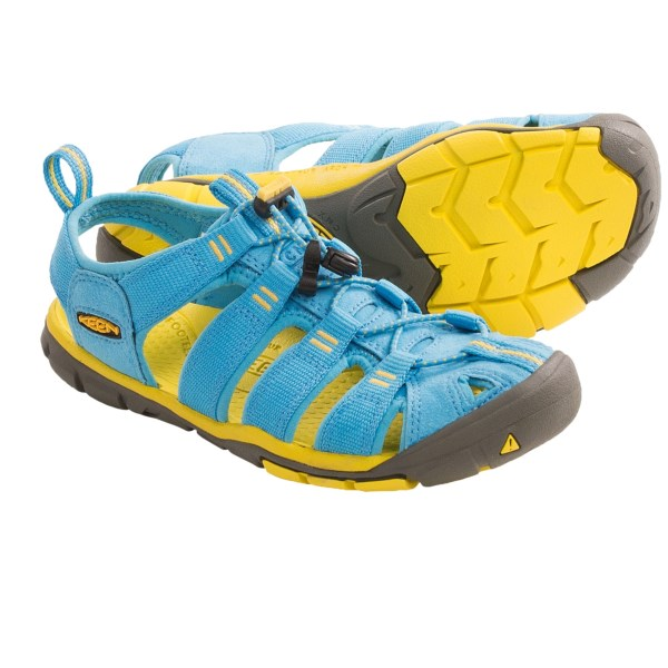 CLOSEOUTS . Ultralight and sporty, Keenand#39;s Clearwater CNX sport sandals feature Keenand#39;s classic protective silhouette with a quick-drying and partially open design that keeps adventurous feet comfy all day long. Available Colors: NORSE BLUE/SUPER LEMON, GREENBRIAR/SPRING/GREEN, MAGNET/RIVER BLUE, ULTRA VIOLET/WHISPER WHITE, ENSIGN BLUE/GREEN SHEEN. Sizes: 5, 5.5, 6, 6.5, 7, 7.5, 8, 8.5, 9, 9.5, 10, 10.5, 11.