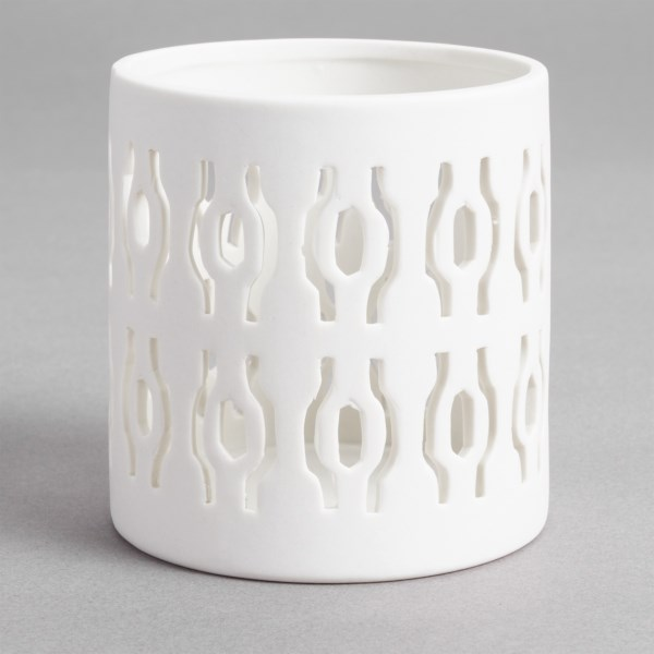 CLOSEOUTS . Do you like candlelight for ambiance? Try something different with Tagand#39;s Solo porcelain votive candle holder. The cutout pattern allows light to shine through, casting the same pattern on the space around the holder. Available Colors: WHITE.