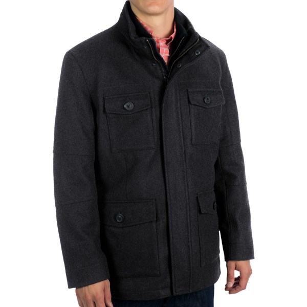 CLOSEOUTS . Great masculine lines, fabulous detail. The Travers coat from Marc New York by Andrew Marc is a warm city coat for the style-conscious man. The robust wool-blend fabric is further fortified by a lightly quilted lining, with zip bib piece providing an extra layer of protection behind the front opening. Available Colors: BLACK, CHARCOAL. Sizes: M, L, XL, 2XL.