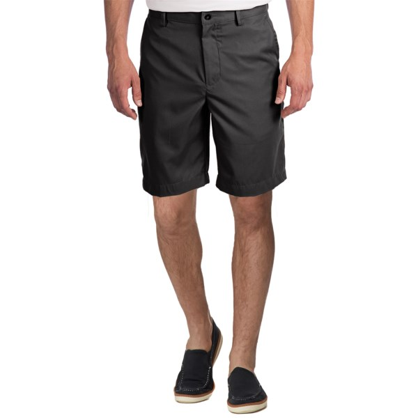 CLOSEOUTS . Handsome classics in a versatile design, Greg Normanand#39;s flat-front shorts feature a brushed-poly twill with a refined, clean-lined look and wrinkle-resistant finish. Available Colors: SANDSTONE, BAMBOO, BLACK.