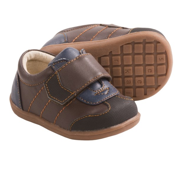 CLOSEOUTS . Just TRY not to ooh and aah at See Kai Runand#39;s Kanoa sneakers. With a sporty leather upper and adorably teeny design, youand#39;ll be dying to see your little oneand#39;s feet in these. Available Colors: BROWN. Sizes: 3, 4, 5, 7.