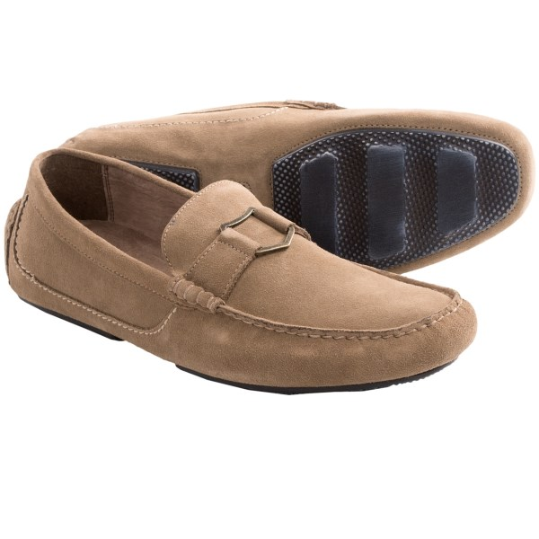 CLOSEOUTS . Crafted of supple suede in a flexible Drivers shoe style, these Andrew Marc Hollis loafers are dressed up with tonal moc toe stitching, Andrew Marc metal hardware vamp detail and luxurious leather lining. Available Colors: LIGHT GREY, ROOTBEER. Sizes: 7.5, 8, 8.5, 9, 9.5, 10, 10.5, 11, 12, 13.