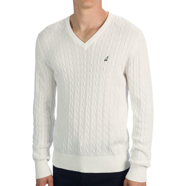 CLOSEOUTS . A classic design in soft cable-knit cotton, the Peak Performance Brady sweater lends a traditional elegance to your cold-weather wardrobe. The V-neck collar and subtle Peak Performance chest logo add balanced touches of refinement to this essential garment. Available Colors: OFFWHITE, CLOUDBURST. Sizes: S, M, L, XL, 2XL.