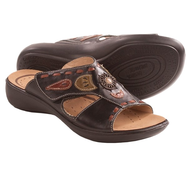 CLOSEOUTS . As exotic as their tropical namesake, Romikaand#39;s Ibiza 50 sandals offer a chic touch of summer style with underfoot comfort beyond your wildest dreams. The rich leather upper is adorned with leather applique accents and a burnished medallion for artsy appeal, and the soft microfiber footbed is anatomically shaped for comfort. Available Colors: BLACK. Sizes: 36, 37, 38, 39, 40, 41.