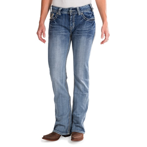CLOSEOUTS . Fade-washed stretch denim, whisker detailing and eye-catching handstitched details adorn Rock andamp; Roll Cowgirland#39;s jeans, but itand#39;s the rhinestone- and leather- adorned back pockets that leave a totally unique, lasting impression. Available Colors: MEDIUM WASH.