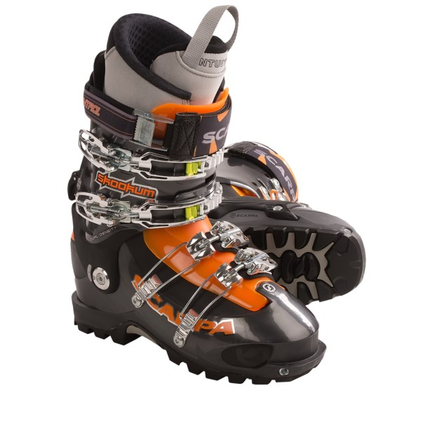 CLOSEOUTS . Scarpa Skookum AT ski boots are built for going big on full-day tours. Customize the flex with two included tongues, then lock down the stiff four-buckle design for the big descent. Available Colors: ANTRACITE. Sizes: 22.5, 23, 23.5, 24, 24.5, 25, 25.5, 26, 26.5, 27, 27.5, 28, 28.5, 29, 29.5, 30, 30.5, 31, 32.