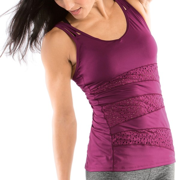 CLOSEOUTS . Get ready to get your glow on during your hot yoga sesh in the Moving Comfort Hot Shot tank top. Constructed with stretchy perforated panels to keep you cool when your body is working hard, this tank is made of blended moisture-wicking and quick-drying polyester so you stay dry, too. Plus, the fun neckline and strappy straps make this trendy top pop -- no more wearing that old T-shirt to class any more. Available Colors: DAYDREAM, FLAME, FLASH, BLACK, CRIMSON, TOPAZ. Sizes: S, M, L, XL.