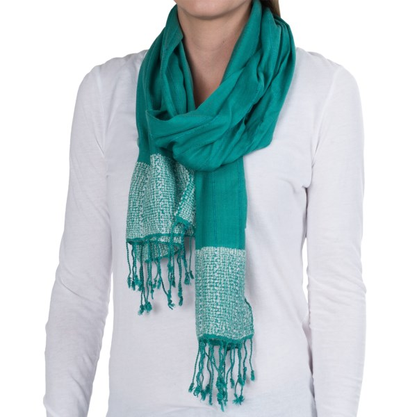 CLOSEOUTS . Made of silky soft viscose fabric with the texture of sewn, raised stripes and sumptuous knit ends, Aventura Clothingand#39;s Perla scarf is the perfect accessory for adding some flare to simple tops and layers. Available Colors: SANGRIA, SEA BLUE, CHAMOMILE. Sizes: O/S.