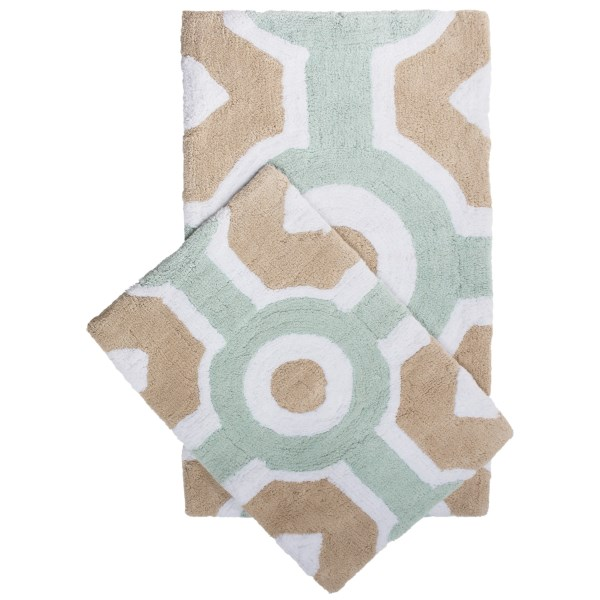 CLOSEOUTS . A great buy on two plush landings for your feet! Youand#39;ll love the silky, toe-pleasing finish of Vista Homeand#39;s Trinity Collection Dorchester bath rugs as much as the softly sculpted geometrics reminiscent of classical architecture. High-loft cotton with heavy stitching on reverse. Available Colors: WHITE/DOVE/LUNARROCK, SKYGREY/SAND DOLLAR/WHITE.