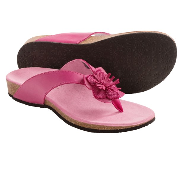 CLOSEOUTS . Whimsical in design, but serious in comfort, Vionicand#39;s Rosario sandals are equipped with foot-healthy, podiatrist-designed Orthaheel Technology. These stabilizing, body-aligning flip-flop-inspired cuties feature a pronounced arch and a deep heel cup for instant comfort and posture correction. Available Colors: BLACK, FUCHSIA. Sizes: 5, 6, 7, 8, 9, 10, 11.