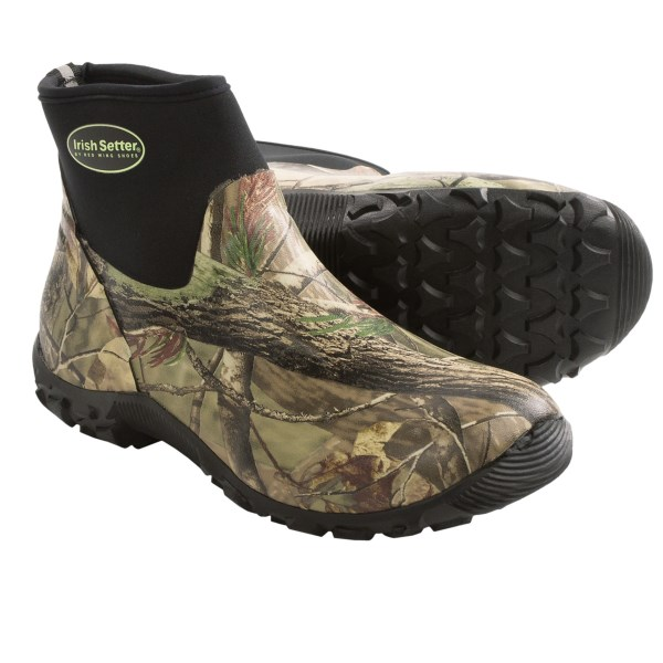 CLOSEOUTS . Keep your feet dry when stomping through muddy and swampy terrain in Irish Setter Taskmaster rubber boots. The waterproof, stretch-fit rubber upper seals out moisture and a lugged outsole delivers dependable traction. Available Colors: REALTREE AP. Sizes: 8.5, 9, 10, 10.5, 11, 12, 7, 8, 9.5, 11.5, 13, 14, 15.