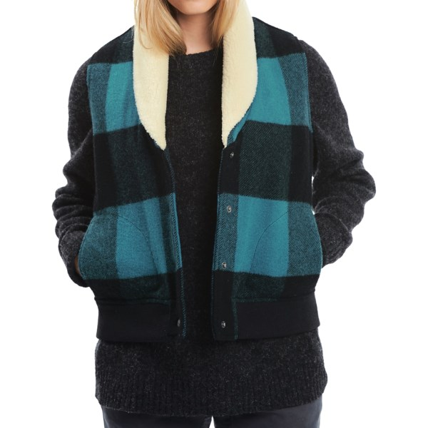 CLOSEOUTS . Straight from the brandand#39;s archives and crafted using Woolrich Mill wool, Woolrichand#39;s Giant Buffalo vest combines a hearty spoonful of warmth with throwback style -- complete with plush sherpa collar lining and oversized plaid. Available Colors: BLUE PLAID, GREY PLAID. Sizes: XS, S, M, L, XL, 2XL, 3XL, 4XL.