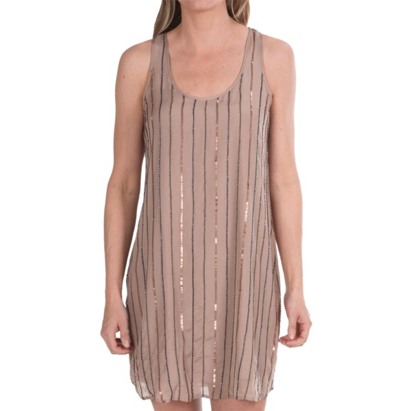 CLOSEOUTS . Simple, yet glamorous, Michael Stars sequin racerback dress is perfectly versatile for any occasion. Made of luxurious silk and decorated with sequins and seed beads, this dress has a stunning look. Available Colors: SAND. Sizes: XS, S, M, L.