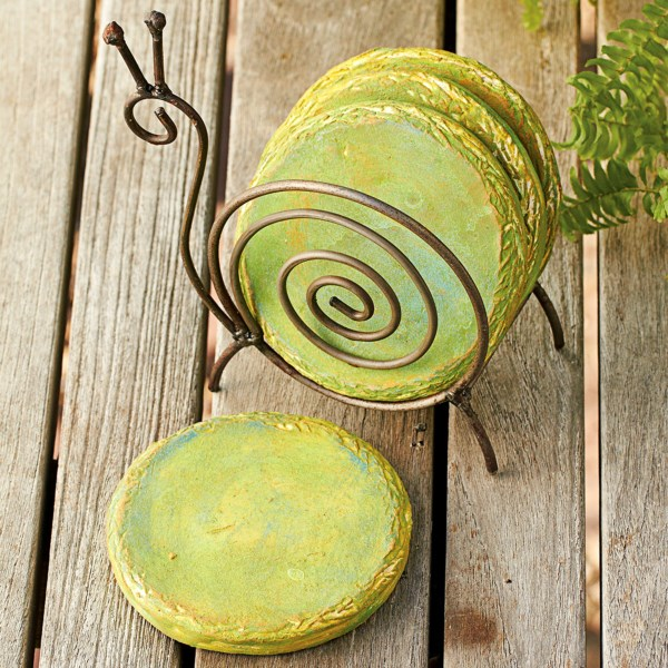 CLOSEOUTS . Color-swirled ceramic coasters nestle inside an animal-shaped metal stand to create Ancient Graffitiand#39;s coasters and stand set, a delightful, nature-inspired accent for your favorite side table. Available Colors: OWL, SNAIL.