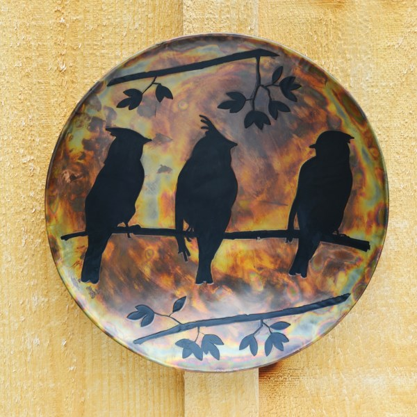 CLOSEOUTS . The Cedar Waxwing, a songbird recognized by its crest and unique colorations, is the silhouetted star of this Ancient Graffiti Flamed wall hanging. A great addition to your patio or organically themed interior decor. Available Colors: BIRDS.