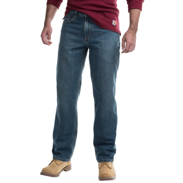2NDS . You get an appreciation for the durability of this jean at first touch. Carharttand#39;s Holter Relaxed Fit denims are made from an 11.75 oz. blend of cotton and polyester (ounce for ounce as strong as 15 oz. denim). They sit slightly below the waist and offer a relaxed fit in the seat and thigh for easy working and living. Available Colors: FRONTIER, BED ROCK.