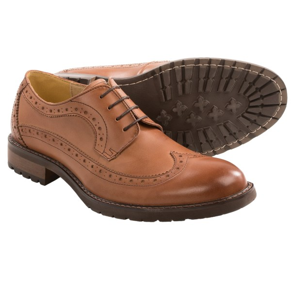 CLOSEOUTS . A thicker, lugged outsole lends a grippy edge to Steve Maddenand#39;s Remaine wingtip oxford shoes, handsome classics versatilely suited for both the office and casual wear. Available Colors: BLACK LEATHER, TAN/BLUE, TAN LEATHER. Sizes: 7, 7.5, 8, 8.5, 9, 9.5, 10, 10.5, 11, 11.5, 12, 13.