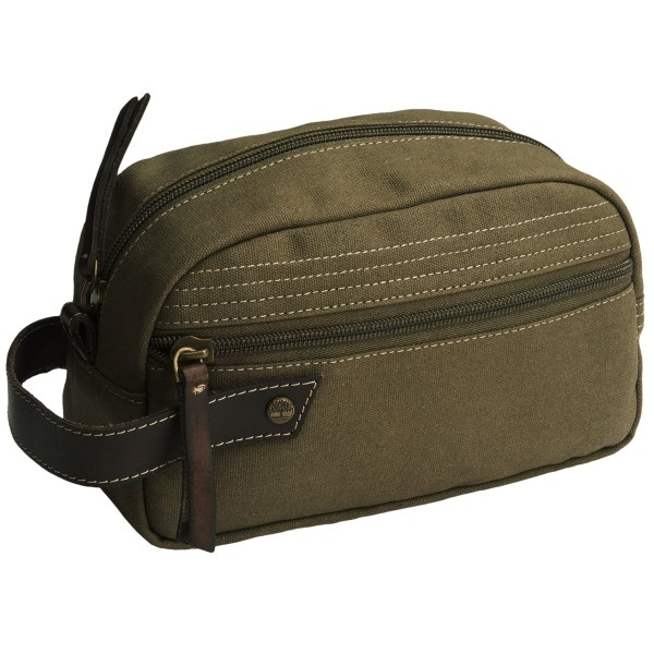 CLOSEOUTS . Timberlandand#39;s canvas travel kit is the ideal size for weekend trips or for convenient storage of essentials at your office desk. The durable canvas has a classic look, and two zip compartments keep items secure. Available Colors: BROWN, OLIVE GREEN, KHAKI.