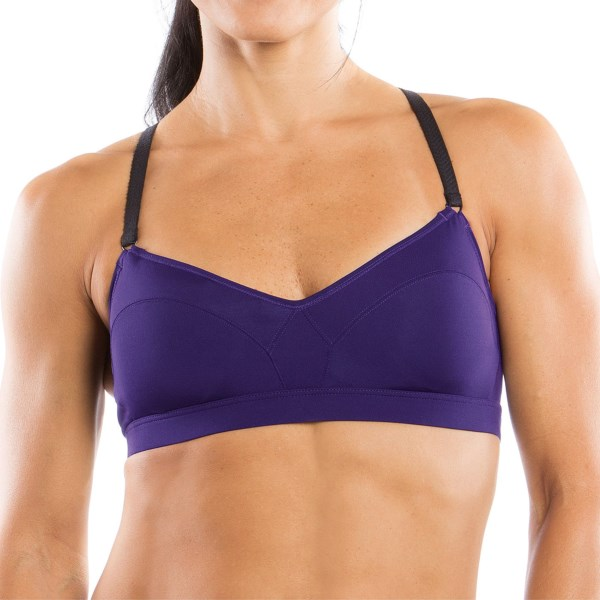 CLOSEOUTS . So cute and perfect for yoga, Moving Comfortand#39;s Hot Shot bra has pretty sweetheart lines and braided straps. Designed for low impact and an A/B cup size, itand#39;s feminine, breathable and fitted with removable padded cups for optional shape and modesty. Available Colors: BLACK/POWERPINK, CRUSH, GEM. Sizes: S, M, L, XL.