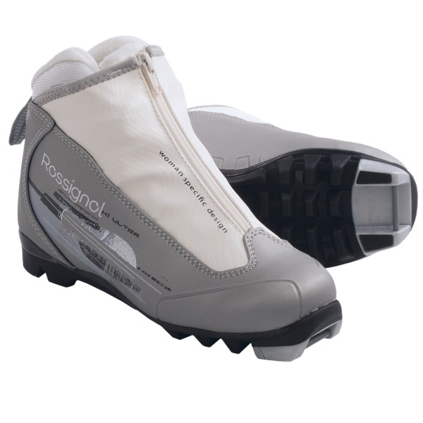 CLOSEOUTS . The Rossignol X1 Ultra FW touring boots is a lace-up classic boot for developing recreational skiers. It features a women-specific fit and Active Control heel for improved response. Available Colors: SILVER. Sizes: 36, 37, 38, 40, 41, 42.