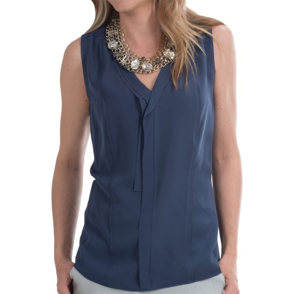 CLOSEOUTS . Pure silk makes its debut in two unique weaves in the creatively imagined Skylar blouse from Elie Tahari. Front is smooth and drapey; back is a textured crepe with light luster. With novel design features throughout. Available Colors: LIME ZEST, MYSTIC. Sizes: S, M, L, XL.