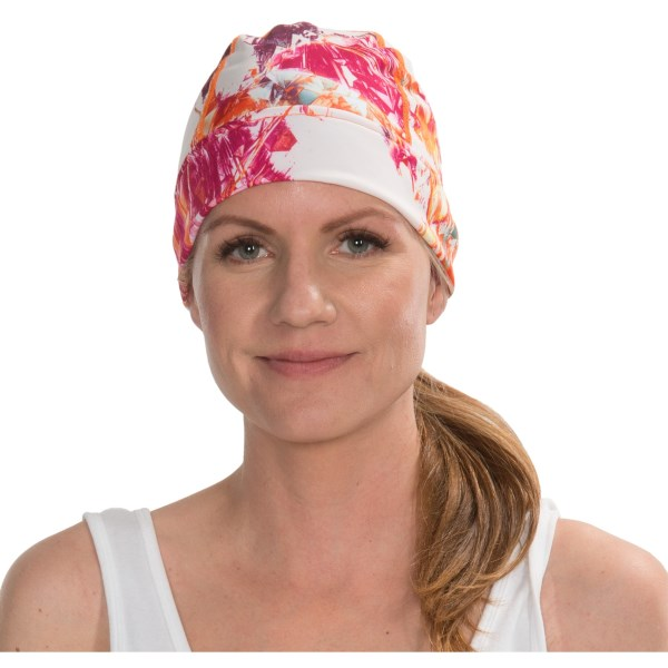 CLOSEOUTS . Made of breathable, quick-drying and moisture-wicking Comfort Shell performance fabric, Turtle Furand#39;s Conquest ponytail beanie hat conquers the uncomfortable ponytail hat bump with a perfectly placed ponytail opening in back. Available Colors: HOT ICE, SACRED DOILY. Sizes: O/S.