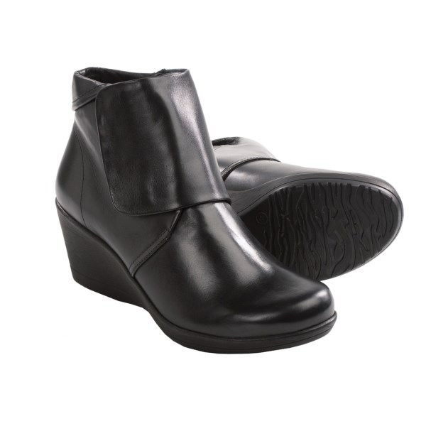 CLOSEOUTS . Wedged booties are all the rage, and Danskoand#39;s Romy boots strike an added note of style with the stylish fold-over cuff. Cute, comfortable, and ready to turn any closet ensemble into a very chic notion. Available Colors: BLACK, BROWN, SLATE KID SUEDE. Sizes: 36, 37, 38, 39, 40, 41, 42.