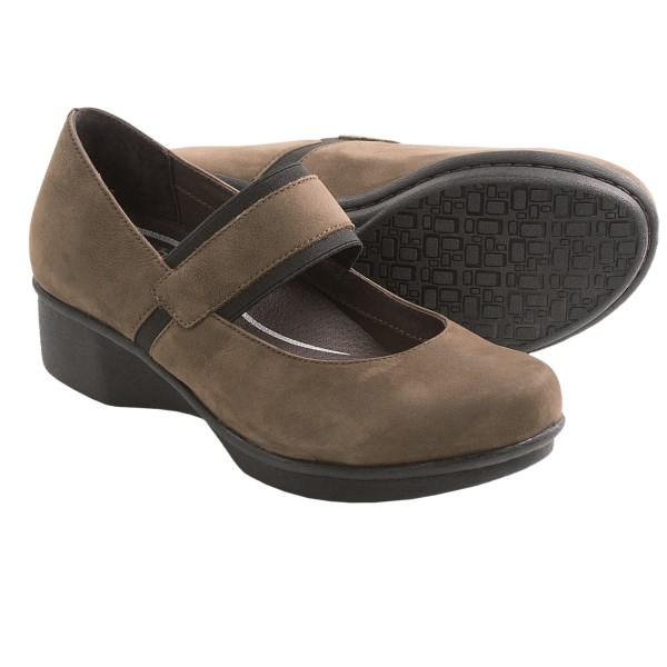 CLOSEOUTS . See your feet through to the end of the day in the fabulous comfort of Dansko. Their Lori Mary Jane shoes get an extra touch of style from the banded, two-tone instep strap to the cored-out midsole with popular wedge architecture. Available Colors: BLACK, BROWN. Sizes: 36, 37, 38, 39, 40, 41, 42.