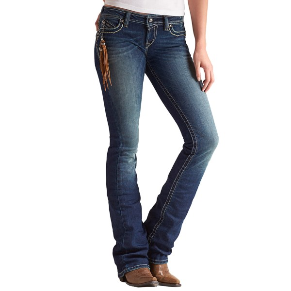 CLOSEOUTS . The sleek and chic style of these slim-fitting low-rise Ariat Ruby Sonora jeans gets a punch of western attitude with a suede coin zip tassel and heavy embroidery on the pockets. Available Colors: DARK CLOUD.