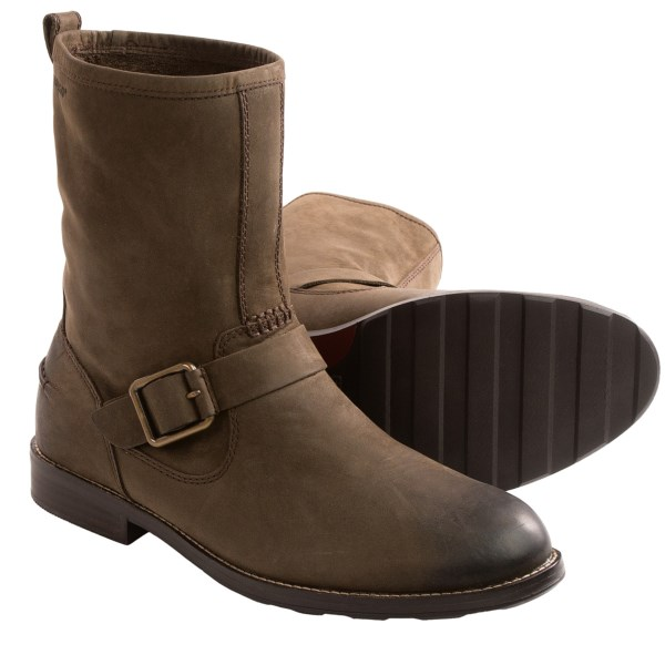 CLOSEOUTS . With a rich, unlined leather upper that boasts a buckle harness strap, stitched heel detail and classic rounded toe, Sebagoand#39;s Coburn harness boots offer the stylish man a winning favorite for his footwear collection. Available Colors: BLACK LEATHER, DARK BROWN LEATHER. Sizes: 8, 8.5, 9, 9.5, 10, 10.5, 11, 11.5, 12, 13.