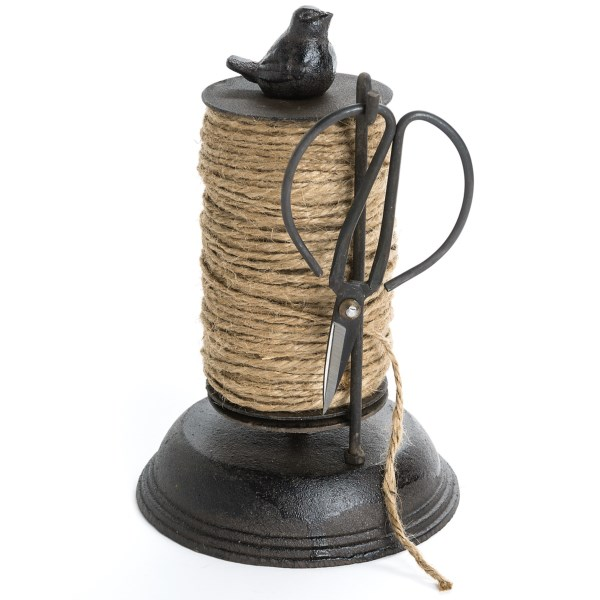 CLOSEOUTS . String up your beans, sweet peas and tomatoes with this whimsical twine dispenser. Tagand#39;s Cast Iron Garden Spindle is made from cast iron with a rich chocolate finish. Working scissors hang ready to snip. Available Colors: CHOCOLATE.